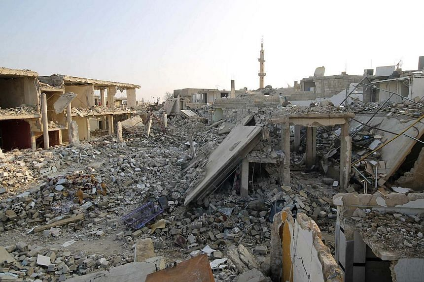 Damaged buildings and debris in Duma, Damascus on Jan 5, 2014. Syrian rebels in the northern Damascus district of Barzeh on Sunday, Dec 5, 2014, agreed to a local ceasefire with President Bashar al-Assad's regime after nearly a year of fighting and b