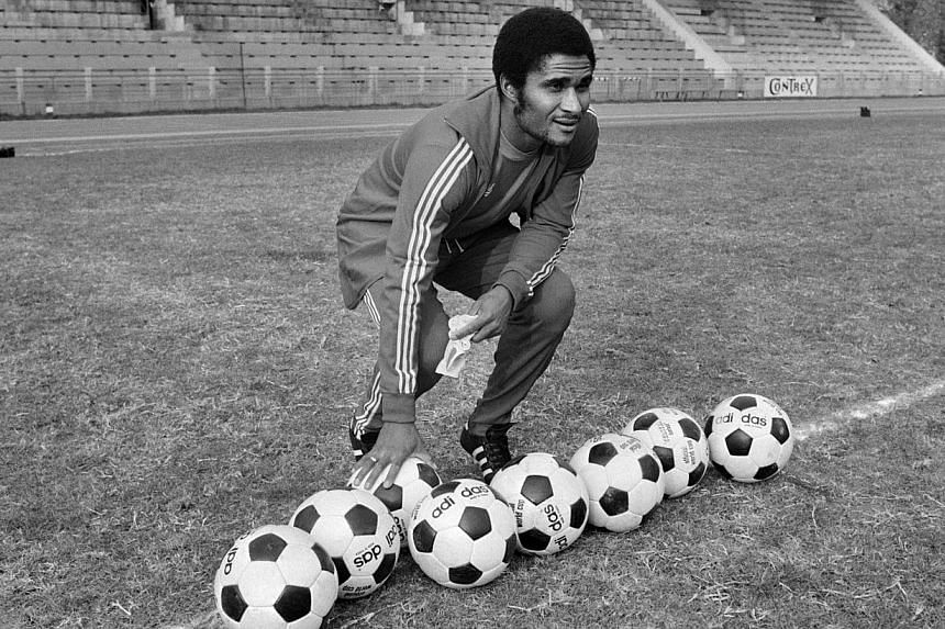 A file picture taken on Oct 30, 1973, in the Bois de Boulogne shows former Portuguese football legend Eusebio da Silva Ferreira, more commonly known as Eusebio, posing with soccer balls. -- FILE PHOTO: AFP