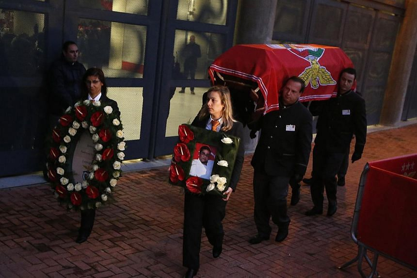 The coffin of Eusebio is carried into Luz stadium in Lisbon on Jan 5, 2014.-- PHOTO: REUTERS
