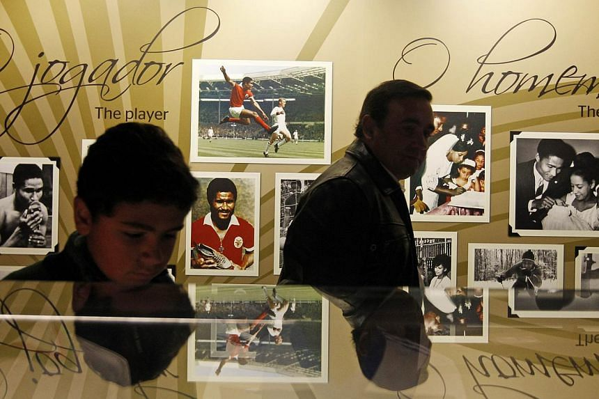 Fans visit a part of Benfica's museum dedicated to late Portuguese football player Eusebio da Silva Ferreira, also known as the 'Black Panther', outside the Luz stadium in Lisbon on Jan 5, 2014. -- PHOTO: AFP