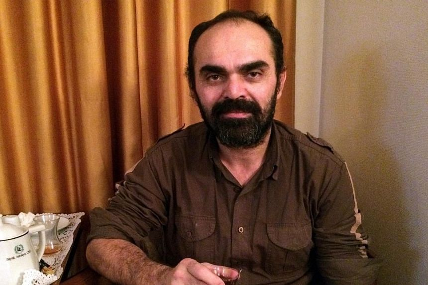 Bunyamin Aygun, a Turkish photographer kidnapped while covering the civil war in neighbouring Syria, poses after he has been freed on January 5, 2014 in Hatay. -- PHOTO: AFP