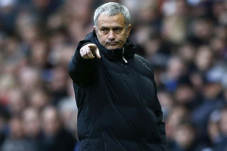 Chelsea manager Jose Mourinho gestures during their English FA Cup soccer match against Derby County at the iPro Stadium in Derby, central England on Jan 5, 2014. Chelsea are not a team of divers, according Mourinho, whose side had a player booked fo