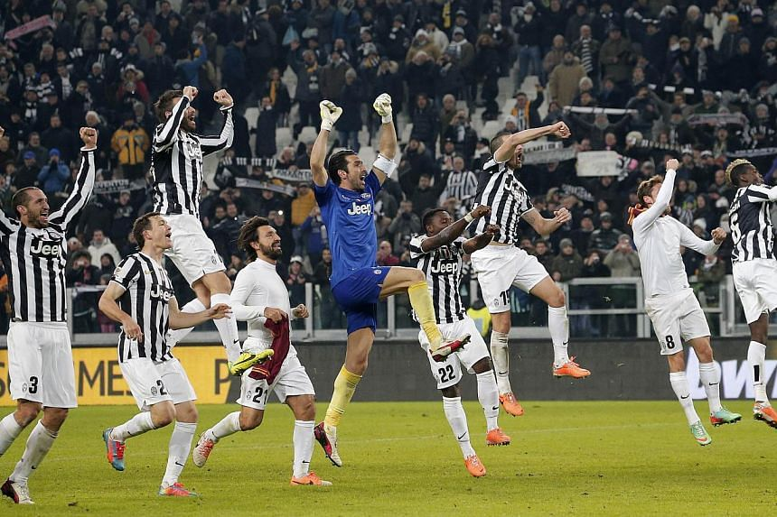 Juventus' players celebrate after winning the Italian Serie A football match Juventus Vs AS Roma on Jan 5, 2014 at Juventus Stadium in Turin. Juventus romped to a 3-0 win over nine-man Roma on Sunday to end the visitors' unbeaten run in the league th