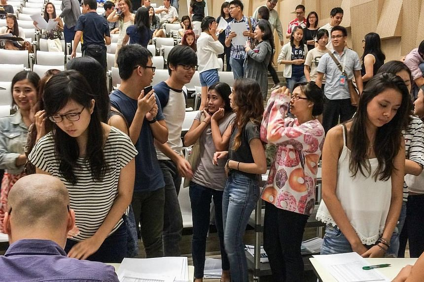 The School of the Arts (Sota) handed out the results for the International Baccalaureate (IB) exam to their students at 2pm on Monday, Jan 6, 2014. -- ST PHOTO:NG SOR LUAN