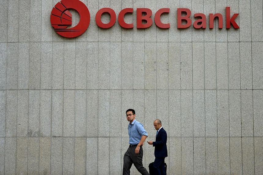 Singapore OCBC's bid to take over Hong Kong's Wing Hang Bank in a deal estimated at US$5.3 billion has raised concerns it may be paying too much for a mid-sized bank and will be tapping shareholders to fund the acquisition. -- ST FILE PHOTO: KUA CHEE