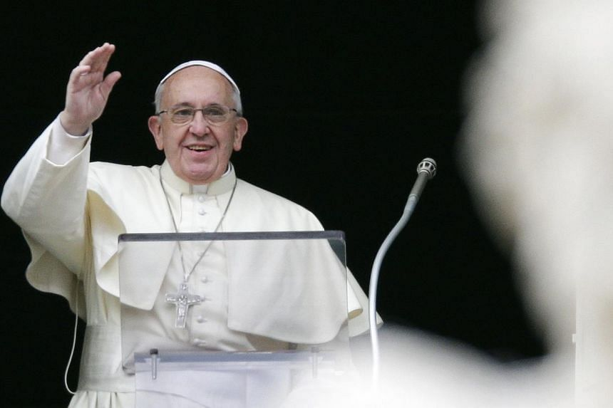 Pope Francis waves as he leads the Angelus prayer from the window of the Apostolic palace in Saint Peter's Square at the Vatican on Jan 5, 2014. Pope Francis said on Sunday he will make his first trip to the Holy Land, visiting Amman, Bethlehem and J