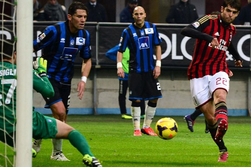 AC Milan's Brazilian forward Kaka kicks and score during the Serie A football match between AC Milan and Atalanta at San Siro Stadium in Milan on Jan 6, 2014. Brazilian forward Kaka boosted his World Cup hopes by scoring his 100th and 101st goal