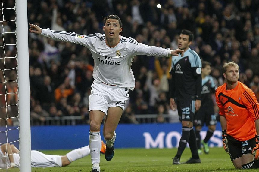 Real Madrid's Cristiano Ronaldo (centre) celebrating his goal against Celta Vigo during their Spanish La Liga match at Santiago Bernabeu stadium in Madrid on Jan 6, 2014. Real Madrid moved back to within five points of La Liga co-leaders Barcelona an