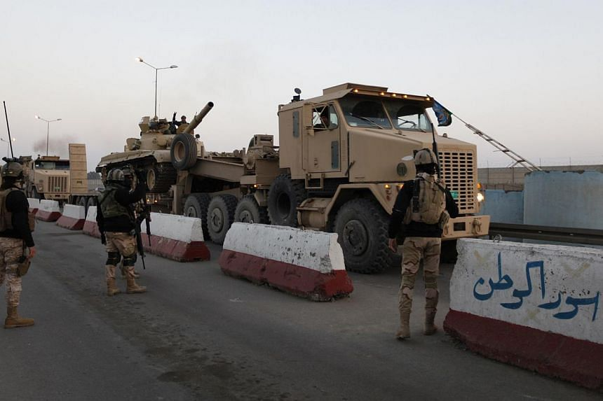 A military convoy drives towards Anbar, to reinforce Iraqi troops in the province, west of Baghdad, on Jan 6, 2014. Iraq's prime minister urged people in the besieged city of Falluja on Monday to drive out al Qaeda-linked insurgents to pre-empt a mil