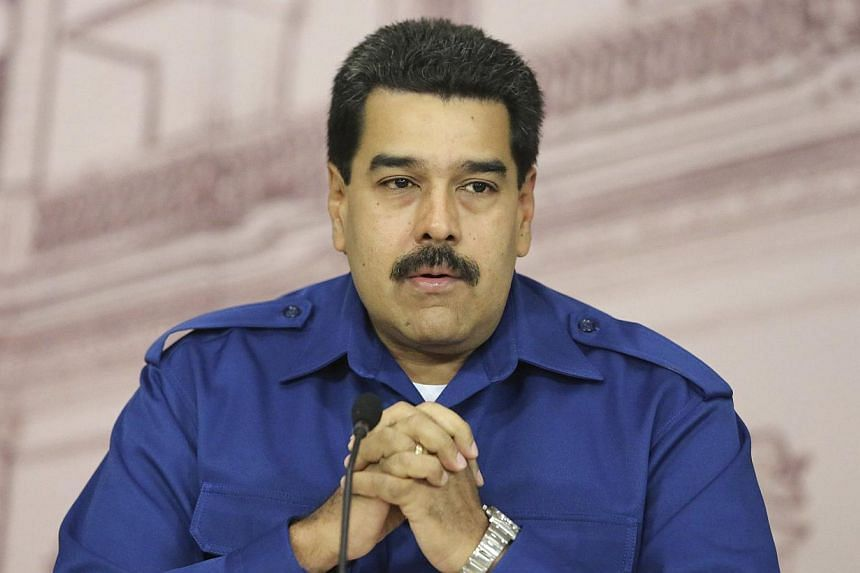 Venezuela's President Nicolas Maduro gestures during a news conference in Caracas in this Dec 30, 2013. President Nicolas Maduro announced on Monday that Venezuela's miniumum wage was being hiked by 10 per cent in a bid to keep up with Latin America'