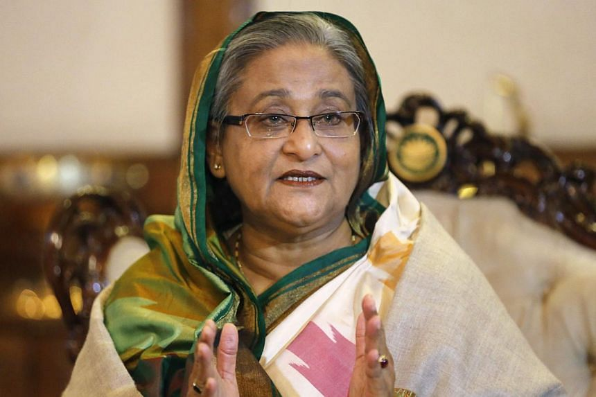 """Bangladesh's Prime Minister Sheikh Hasina speaks during a media conference in Dhaka on Jan 6, 2014. Bangladesh's opposition leader Khaleda Zia accused Ms Hasina of """"murdering democracy"""" as her arch rival faced growing calls on Tuesday to hold fresh p"""