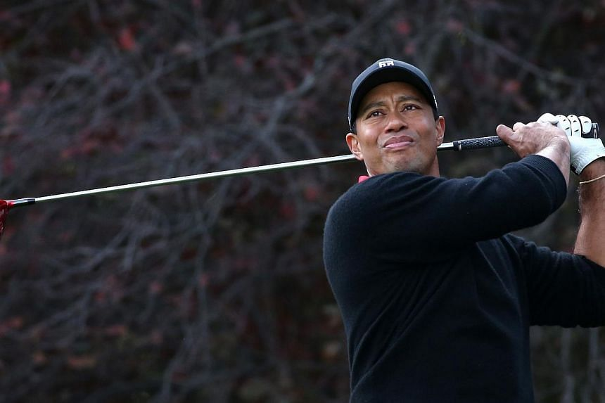 Tiger Woods hits his tee shot on the second hole during the final round of the Northwestern Mutual World Challenge at Sherwood Country Club on Dec 8, 2013 in Thousand Oaks, California.World number one Tiger Woods will launch his 2014 campaign a