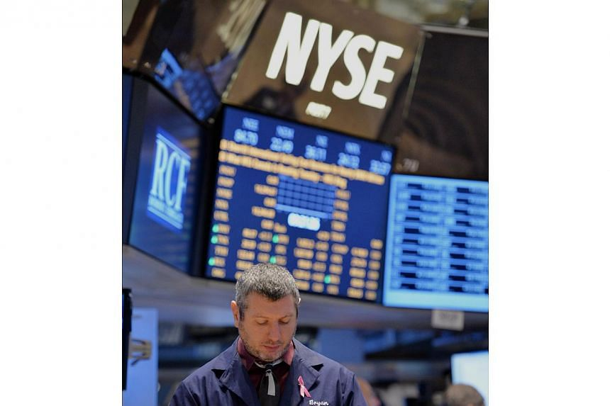 A trader works on the floor of the New York Stock Exchange on Dec 24, 2013 in New York.United States (US) stocks slipped on Monday after a mixed batch of economic reports, which showed a slowdown in growth in the US services sector and a reboun