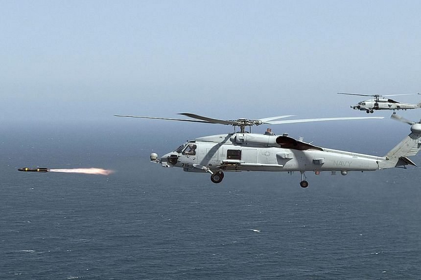 This Apr 23, 2008 United States(US) Navy photo shows an MH-60R Seahawk firing a Hellfire missile during training near San Diego, California. USsaid on Monday it would speed up its deliveries of missiles and surveillance drones to Iraq as the Ba