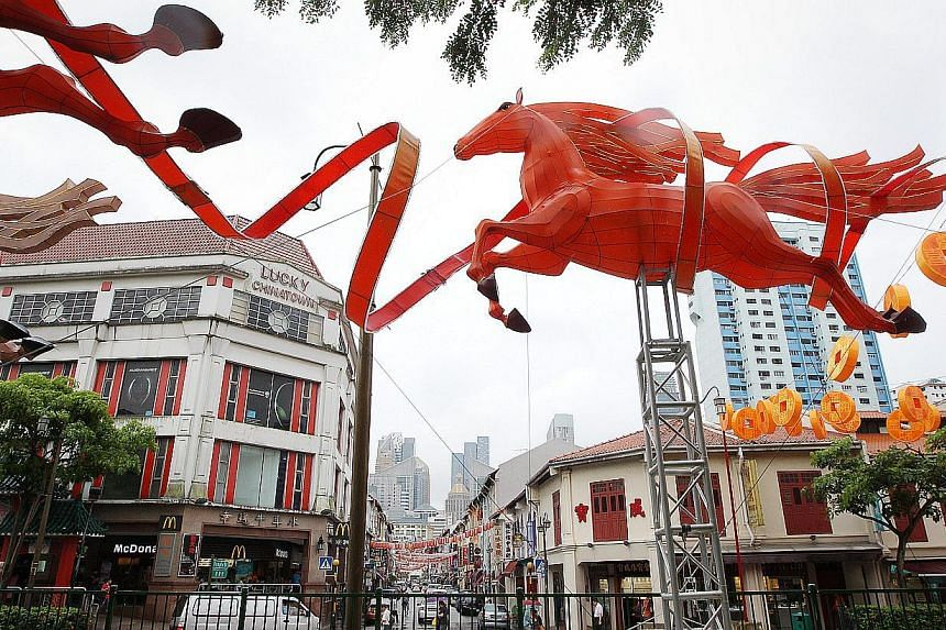 Chinatown will be lit with 88 life-sized horse-shaped lanterns and dazzling gold coins to usher in the Year of the Horse. -- ST FILE PHOTO: ONG WEE JIN