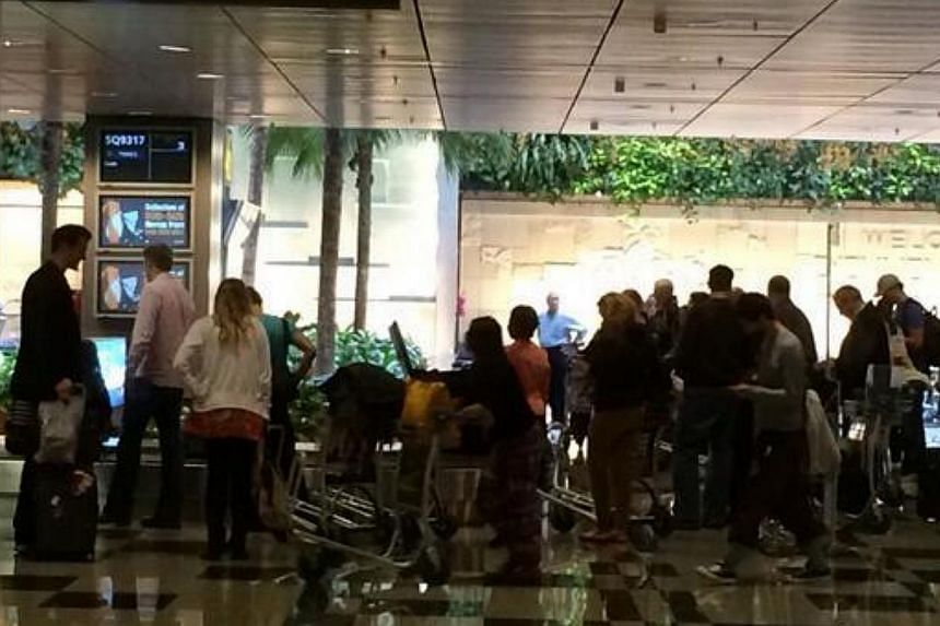 Passengers on Singapore Airlines flight SQ317, which made an emergency landing in Azerbaijan, arrived at Singapore's Changi Airport as scheduled at 3.34pm. The flight arrived from Baku as SQ9317.-- ST PHOTO: DERRICK HO