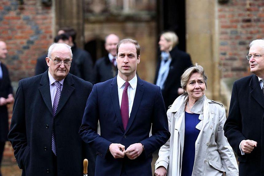 Britain's Prince William, Duke of Cambridge, (second left) arrives at St John's College, Cambridge University, alongside Leszek Borysiewicz (left) Vice Chancellor University of Cambridge, Polly Coutice (second right) Director of Cambridge Programme S