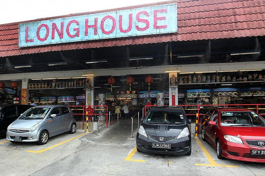 The popular Longhouse food court has been acquired by a listed developer to make way for a commercial/residential mixed development. -- ST PHOTO: LAU FOOK KONG