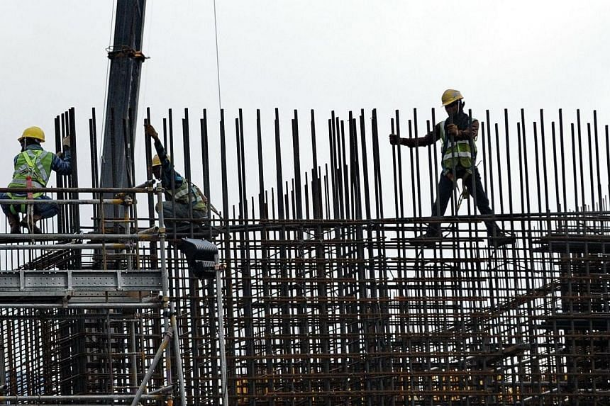 Employers now have to report to the Manpower Ministry (MOM) if their injured workers get more than three days of medical leave, even if these were not consecutive days. -- PHOTO: AFP