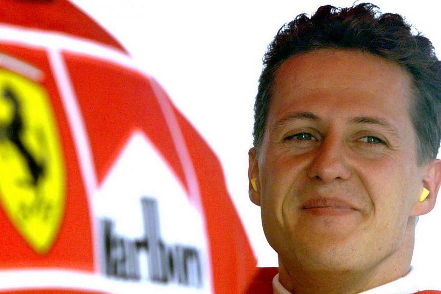 "There has been a ""slight improvement"" in Michael Schumacher's condition, a source close to the Formula One legend said on Monday, eight days after a skiing accident left him with life-threatening injuries. -- PHOTO: REUTERS"