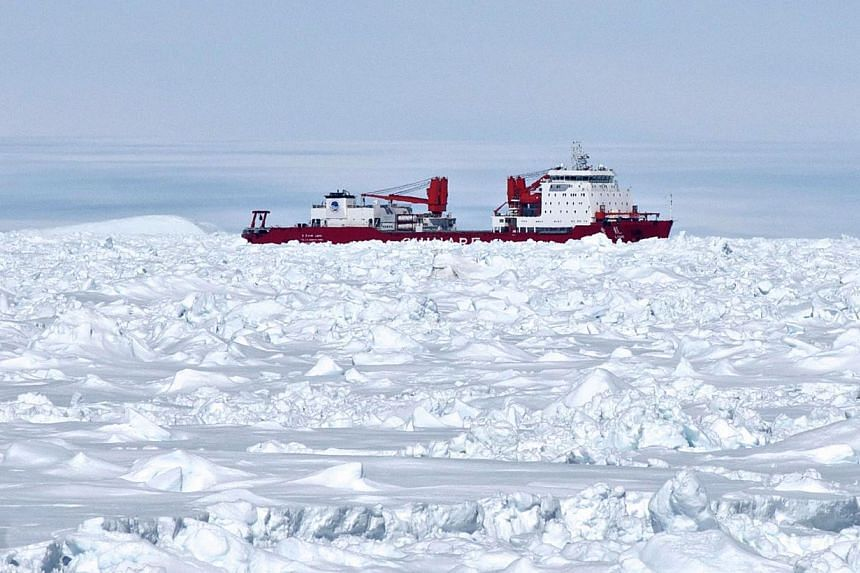 This photo released by the Australian Antarctic Division on Jan 2, 2014, shows the Chinese Antarctic vessel Xue Long (centre) from the bridge of the Aurora Australis ship off Antarctica, both in the frozen waters to help rescue a nearby Russian resea