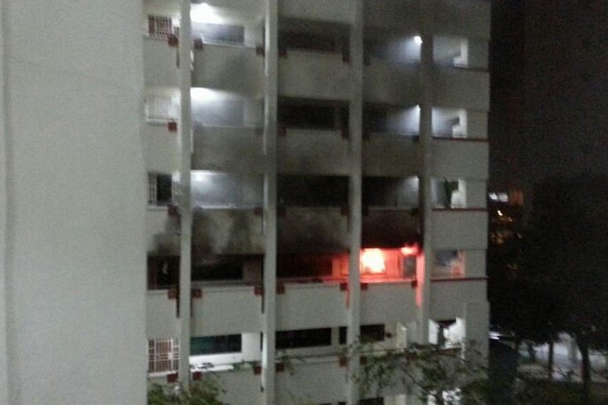 A fire broke out in a HDB unit in Compassvale Walk at about 1am on Wednesday, forcing a family out of their home. -- PHOTO: WAN BAO