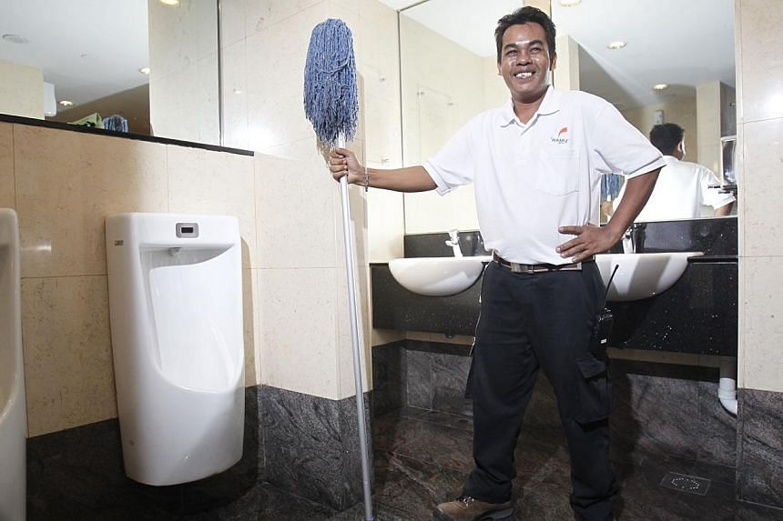 Mr Arif Bin Jumaat, 40, a cleaner at NTUC Building, on 8 January 2014.Cleaning companies will come under a compulsory licensing scheme in September where they have to pay cleaners wages according to a tiered structure negotiated with unions.&nb