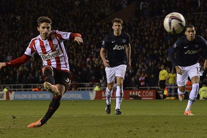Sunderland's Fabio Borini scoring a penalty against Manchester United during their English League Cup semi-final first leg soccer match at the Stadium of Light in Sunderland on Jan 7, 2014. -- PHOTO: REUTERS