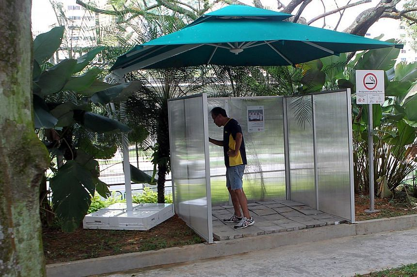 One of six designated smoking areas, each measuring 3m by 3m, in Nee Soon South Zone D, which is a community-led, smoke-free zone. They are located in open-air spaces such as grass patches.
