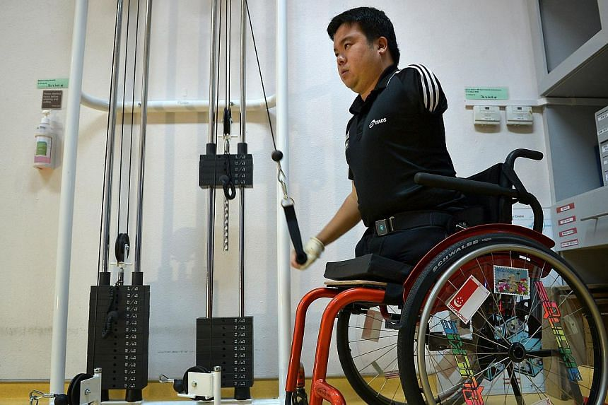 Chee, who lost his legs and arm in a 2012 accident, doing strength training at Thye Hua Kwan Hospital. ''Sport is a form of rehabilitation,'' he says. -- ST PHOTO: KUA CHEE SIONG