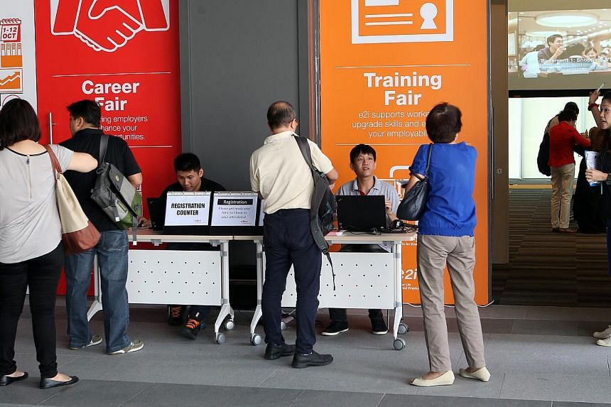 People at a job fair held at the Employment and Employability Institute in Jurong East. The Hudson report said bad bosses and a desire for higher pay are two main factors pushing workers to look for new jobs. -- ST PHOTO: LAU FOOK KONG