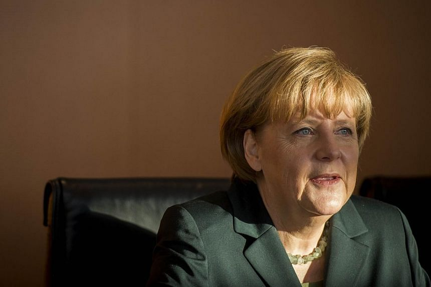 German Chancellor Angela Merkel leads the weekly cabinet meeting at the Chancellery in Berlin on Jan 8, 2014.Germany saw a boost to its population last year due to the biggest influx of immigrants in two decades, mainly from Europe's crisis-hit
