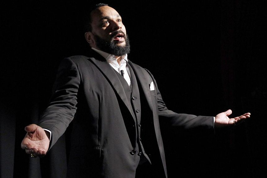 This picture taken on Jan 15, 2012, shows French controversial humorist Dieudonne Mbala Mbala delivering a speech prior to the premiere screening of his movie Antisémite (Anti-Jewish) on the stage of the Main d'Or theatre in Paris. Dieudonne, w