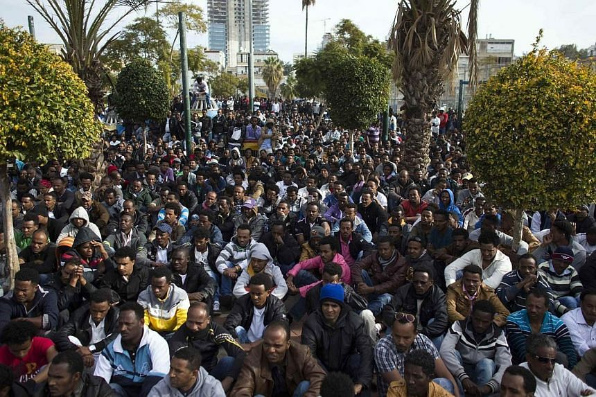 African migrants gather in Tel Aviv's Levinsky park on the third day of protests against Israel's detention policy toward migrants it sees as illegal job-seekers on Tuesday. More than 10,000 African asylum seekers rallied outside Israel's parliament