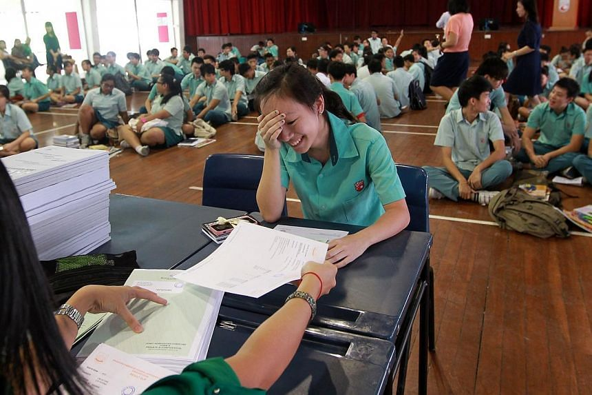 A student receives her O-Level results at Si Ling Secondary School in 2013.The results of the GCE O-Level Examination will be released on Monday, Jan 13, 2014. -- ST FILE PHOTO:SEAH KWANG PENG