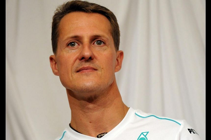 Mercedes driver Michael Schumacher of Germany listens to question while attending the Mercedes press dinner meeting after the qualifying session of the Formula One Japanese Grand Prix at the Suzuka circuit, on Oct 6, 2012. Investigators probing Micha