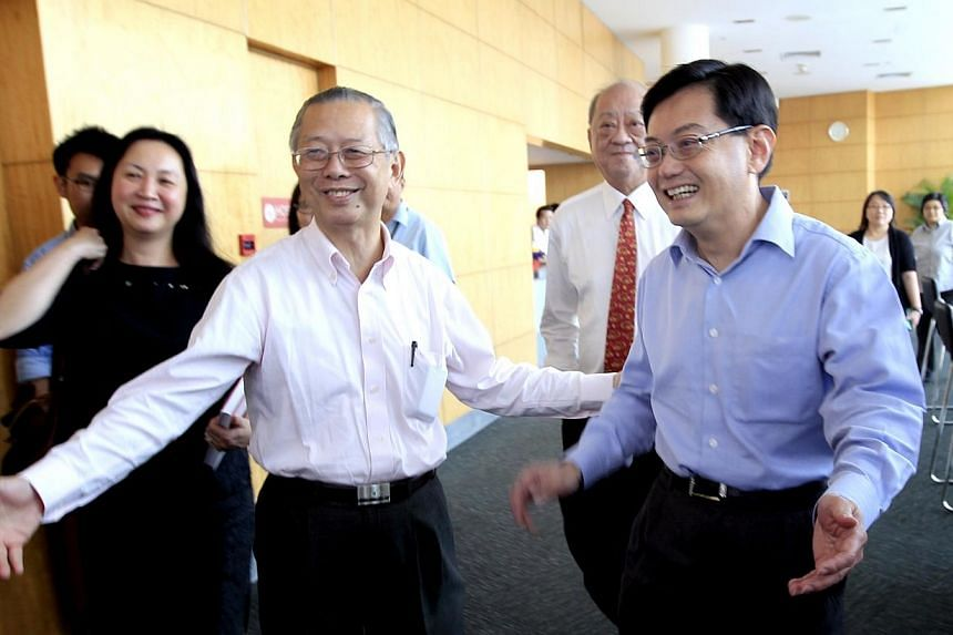 Former civil service chief Lim Siong Guan(left) and Education Minister Heng Swee Keat (right) at the launch of Mr Lim's book, The Leader, The Teacher And You: Leadership Through The Third Generation. Singapore's leaders will not waver on two co