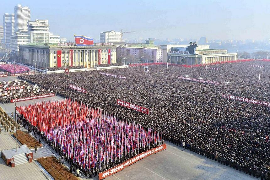 People gather at a rally to exhort the objectives that North Korean leader Kim Jong-Un suggested in his New Year speech, at Kim Il-Sung square, in this undated photo released by North Korea's Korean Central News Agency (KCNA) in Pyongyang on Jan 6, 2