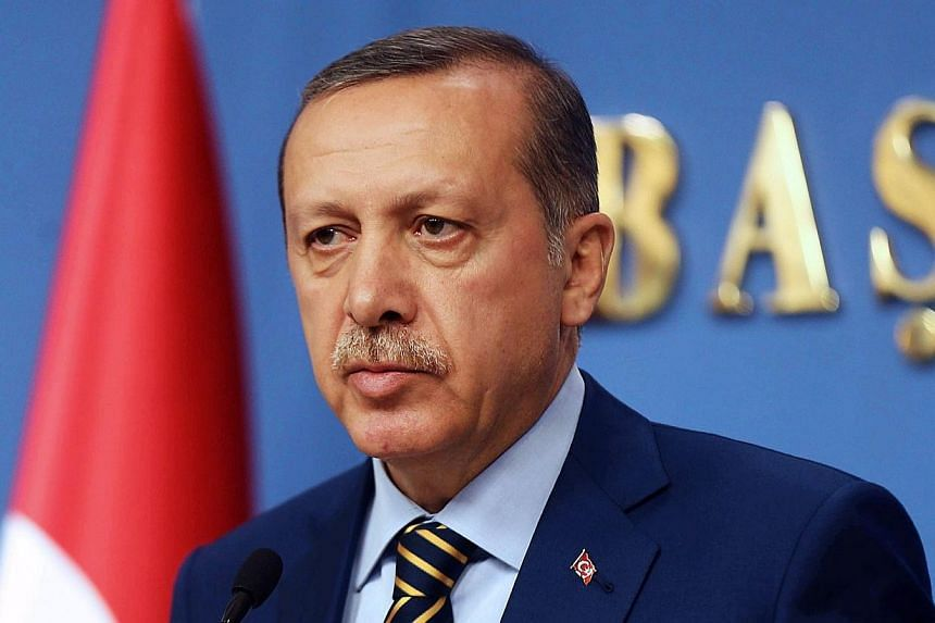This picture taken on Dec 25, 2013, shows Turkish Prime Minister Recep Tayyip Erdogan during a press conference in Ankara. Mr Erdogan will arrive in Singapore today for his first official visit. -- FILE PHOTO: AFP