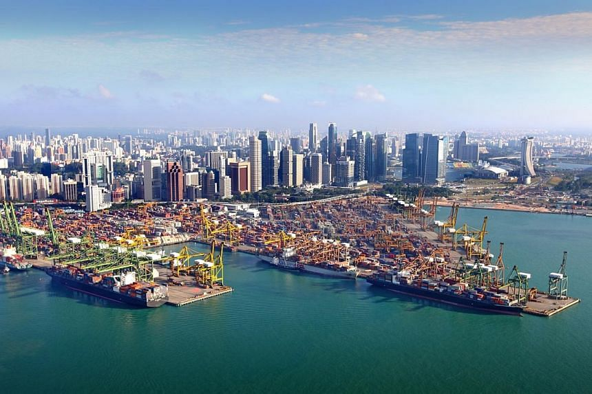 Tanjong Pagar Terminal. PSA International handled 61.81 million boxes at its port projects around the world last year, up 2.9 per cent. -- PHOTO: PSA