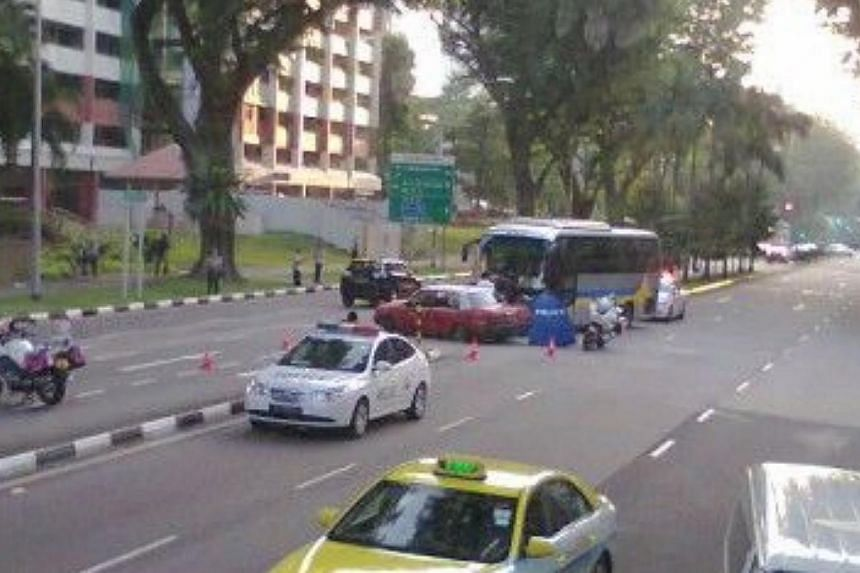 A TransCab taxi driver was killed in a crash between his vehicle and a private bus at Ang Mo Kio Ave 3 on Wednesday morning. -- PHOTO: COURTESY OF MR KOH
