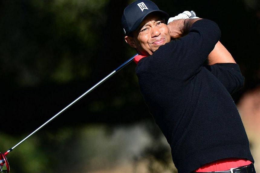 US golfer Tiger Woods tees off at the sixth hole during the final round of the Northwestern Mutual World Challenge golf tournament at the Sherwood Country Club in Thousand Oaks, California, on Dec 8, 2013. Woodshas cracked US$1.3 billion (S$1.6