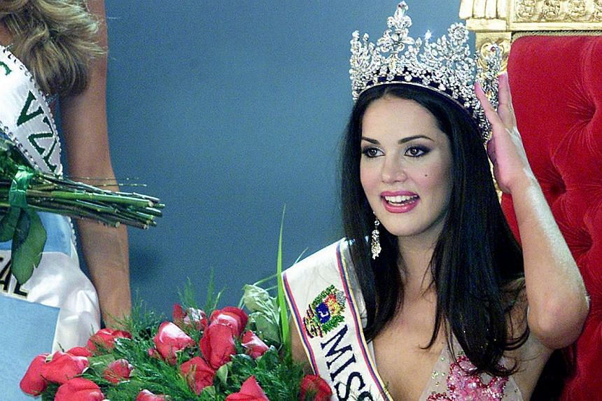 Venezuelan Monica Spear poses after being elected Miss Venezuela, in Caracas, on Sept 23, 2004.Assailants shot dead the former Miss Venezuela and her ex-husband in the latest high-profile case of violent crime in the South American nation, auth