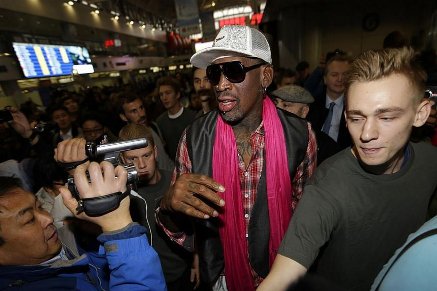 """Former NBA basketball player Rodman is surrounded by journalists as he arrives at the Beijing Capital International Airport to leave for Pyongyang, in Beijing earlier this week. Rodman sang """"Happy birthday to you!"""" to North Korean leader Kim Jong-Un"""
