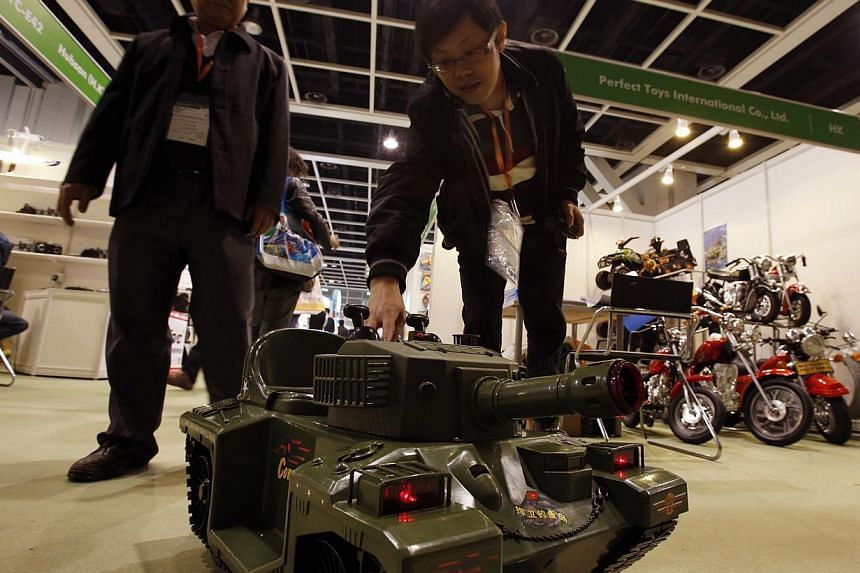 A remote-controlled toy tank, which a small child can sit on, is being demonstrated at the Hong Kong Toys and Games Fair on Jan 6, 2014. -- FILE PHOTO: REUTERS