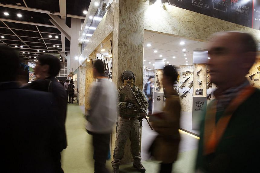 Visitors walk past a man dressed as a toy soldier at the Hong Kong Toys and Games Fair on Jan 6, 2014. -- FILE PHOTO: REUTERS