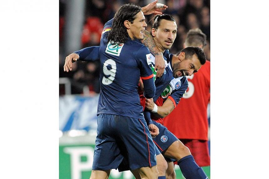 Paris Saint-Germain's Swedish forward Zlatan Ibrahimovic (centre) celebrates with Uruguayan striker Edinson Cavani (left) and Argentine forward Ezequiel Lavezzi (right) after scoring a goal during the French League Cup football match between Brest an