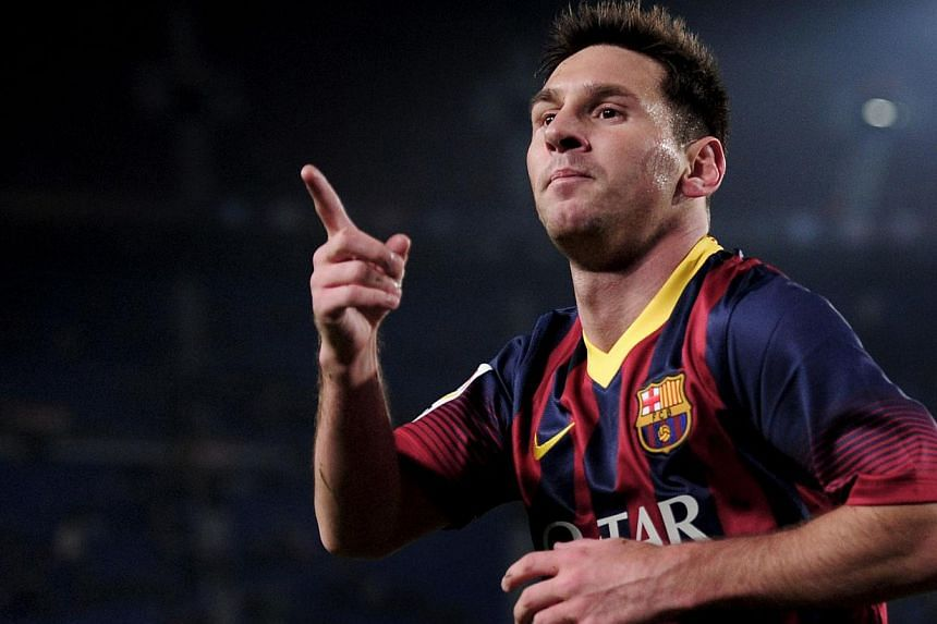 Barcelona's Argentinian forward Lionel Messi celebrating his goal during the Spanish Copa del Rey (King's Cup) football match against Getafe at the Camp Nou stadium in Barcelona on Jan 8, 2014.  -- PHOTO: AFP