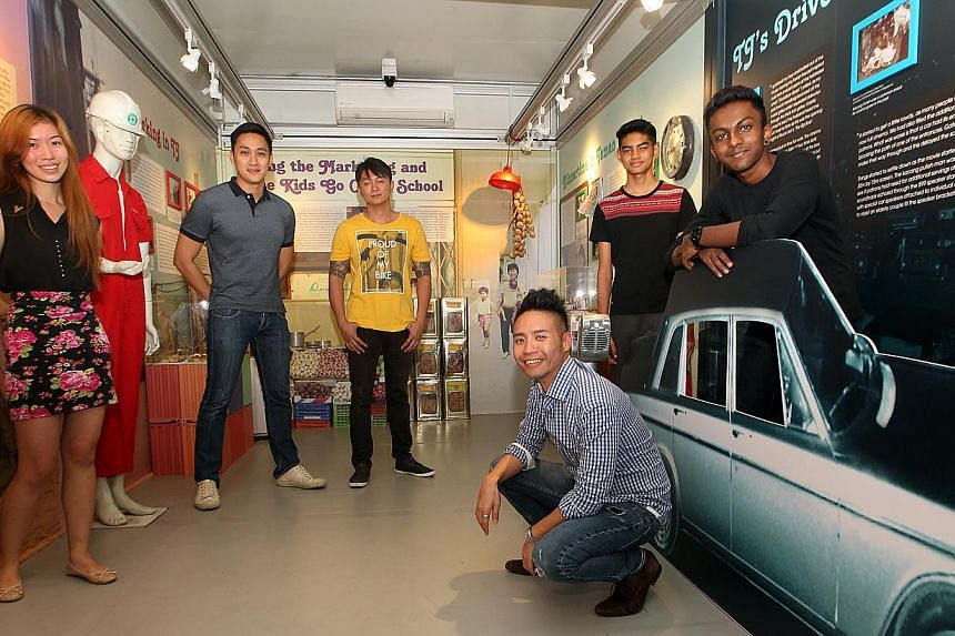 NHB's Mr David Chew (squatting) with some contributors to the new galleries (from left) NTU undergraduate Louise Evangeline Ng, 22; volunteer curator Daniel Leong, 26; Beacon of Life Academy Arts Club founder Kim Whye Kee, 34; and arts club members M
