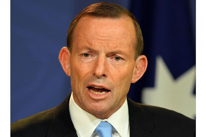 Australia Prime Minister Tony Abbott speaking at a press conference in Sydney on on Dec 16, 2013. Mr Abbott defended the government's secrecy over its border protection policy on Thursday after reports that boats had been turned back to Indonesia and